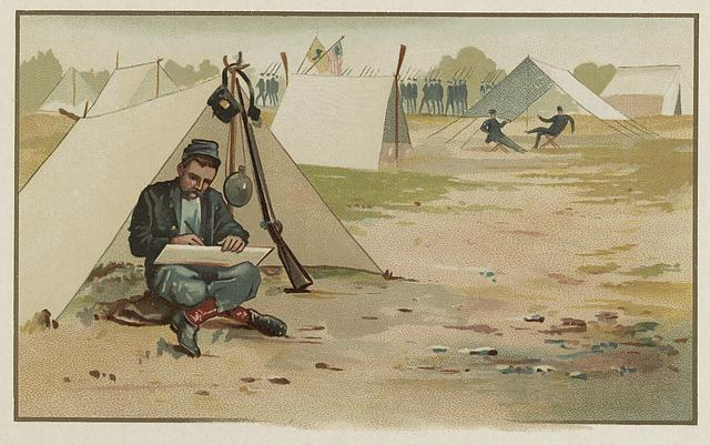 [Union soldier making a drawing while sitting in front of tent at army camp]