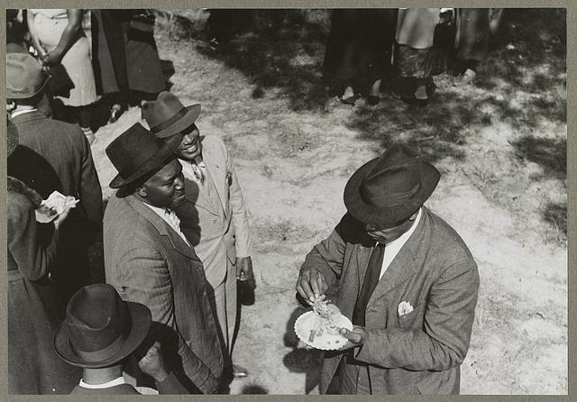 Yanceyville (vicinity), N.C. Participants in an outdoor picnic which is being held during the noon intermission of a meeting of ministers and deacons at a Negro church