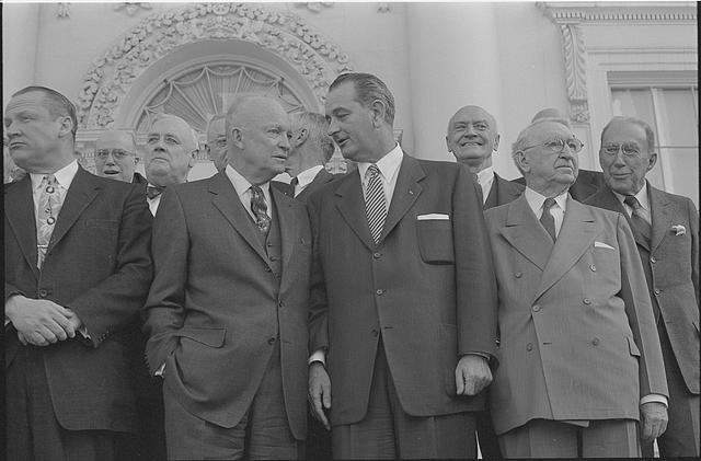 [President Dwight D. Eisenhower standing with Lyndon B. Johnson (center),John Foster Dulles (right) and other guests, during a bipartisan luncheon at the White House, Washington, D.C.]