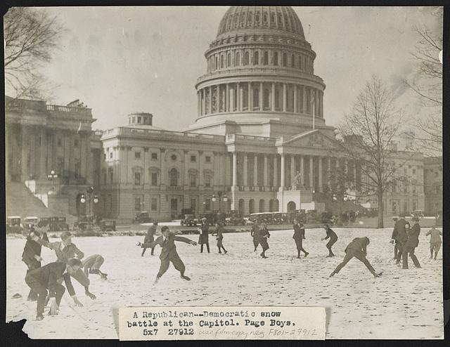 A Republican-Democratic snow battle at the Capitol. Page boys