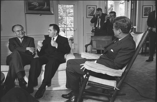 [(l-r) Soviet ambassador to the US, Anatoly F. Dobrynin and Soviet foreign minister Andrei Gromyko  talking with President Kennedy who is seated in rocking chair, at the White House, Washington, D.C.]