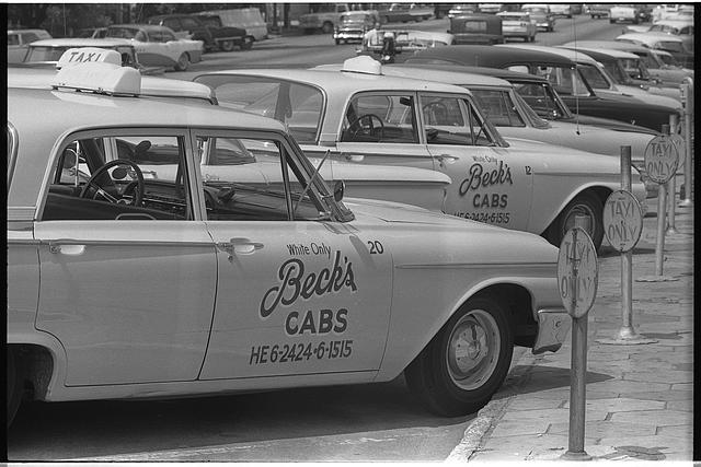 "[Taxi cabs with sign ""White only, Becks cabs"" on side, Albany, Georgia]"