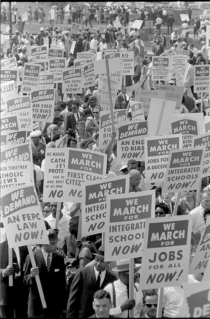 [Demonstrators marching in the street holding signs during the March on Washington, 1963]