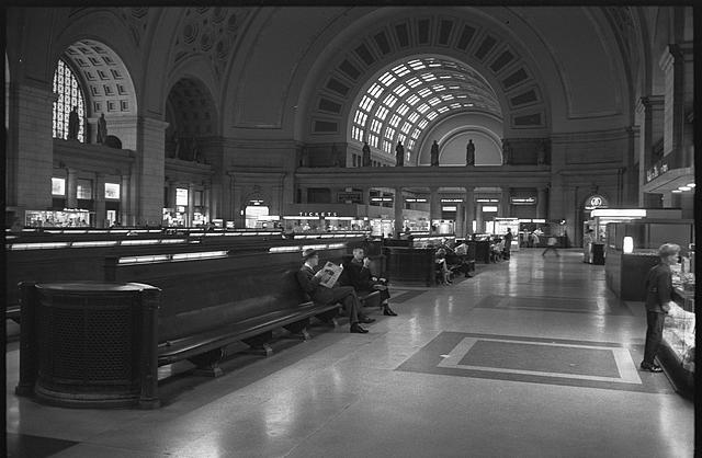 [Passengers seated in long benches in the waiting room of Union Station, Washington, D.C.]