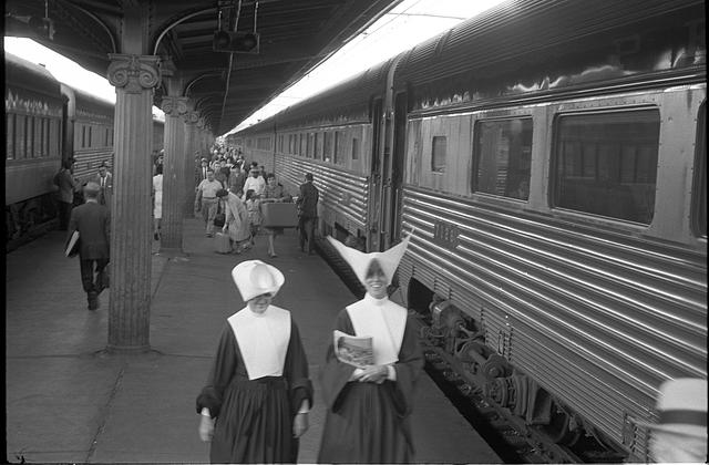 [Passengers including nuns walking near trains, Union Station, Washington, D.C.]