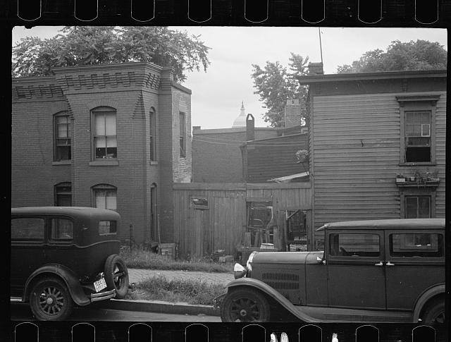 [Untitled photo, possibly related to: A once proud section, Washington, D.C. These houses now are overcrowded with a Negro population and greatly in need of more sanitary methods]