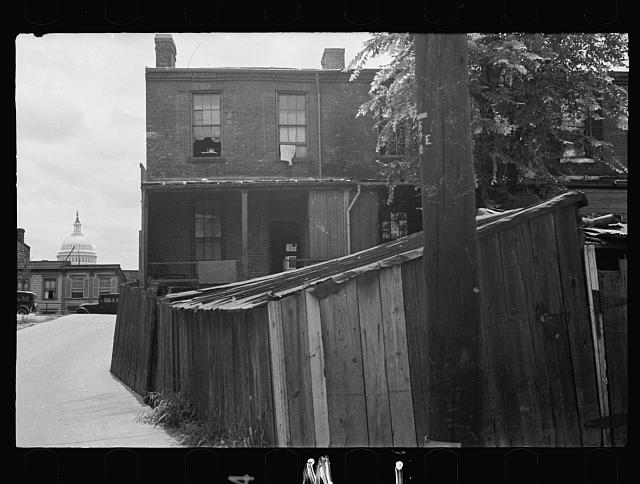 [Untitled photo, possibly related to: Once with happier surroundings, this section now houses a large crowded Negro population living in most unsanitary conditions, Washington, D.C.]