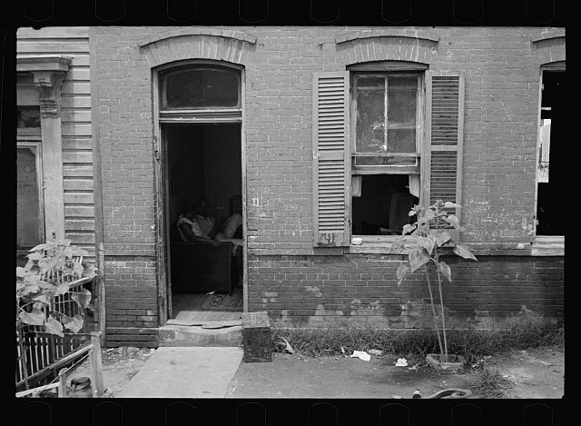 Front of Negro home near Capitol, Washington, D.C. Interiors of these homes vary little. A chair or two and a table, a bed and perhaps an extra mattress on the floor cares for six to ten people