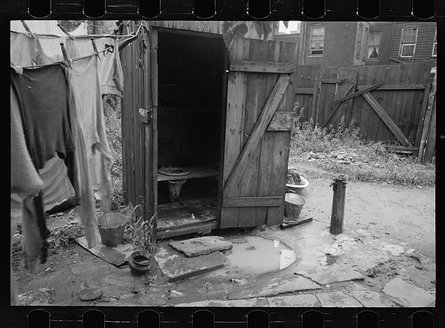 Backyard and privy near Government Printing Office, Washington, D.C. The pump on the right supplies water for the house back of privy
