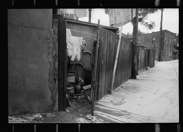 Alley dwelling near Union Station, showing overcrowded, tiny backyards, Washington, D.C.