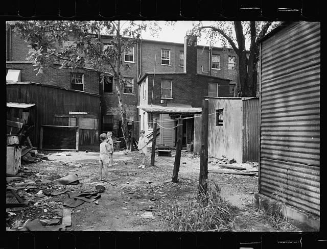 Children in slum area, Washington, D.C. Children in their backyard in a slum area near the Capitol. This area inhabited by both black and white
