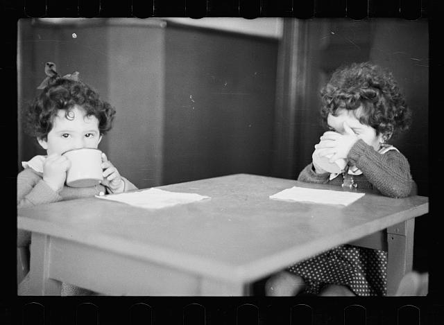 [Untitled photo, possibly related to: Radburn, New Jersey, a privately financed model town which furnished some of the ideas for the United States Suburban Resettlement Administration's Greenbelt towns. Young artist at the community kindergarten]