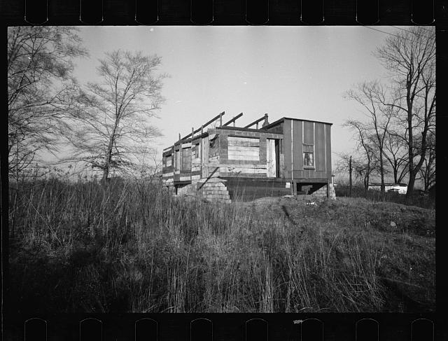 [Untitled photo, possibly related to: Cheap partly-constructed houses lacking water and sewage, Lockland, Ohio]