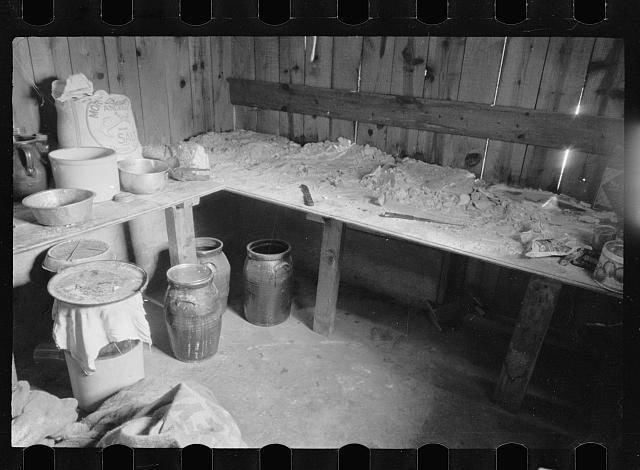 [Untitled photo, possibly related to: Kitchen and washroom of two room mountain shack, Route U.S. 11, a few miles east of Marshall, North Carolina]