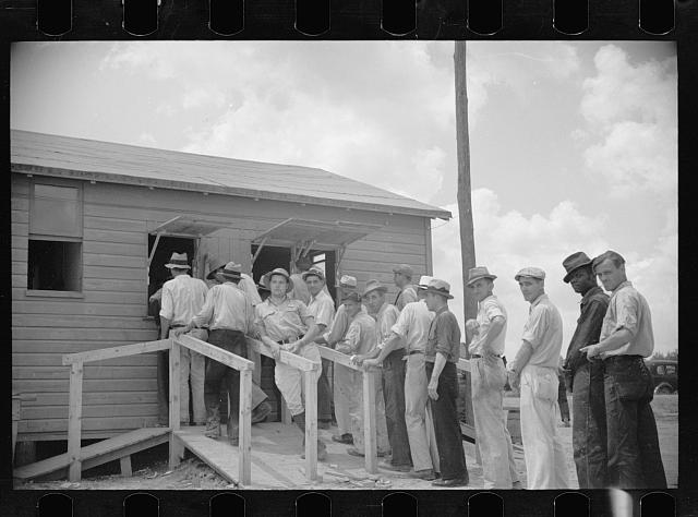 Workmen receiving paychecks, Greenbelt, Maryland