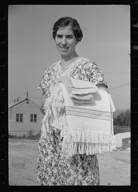 [Untitled photo, possibly related to: Homesteaders carrying shawls, etc., woven at Tygart Valley Homesteads, West Virginia]