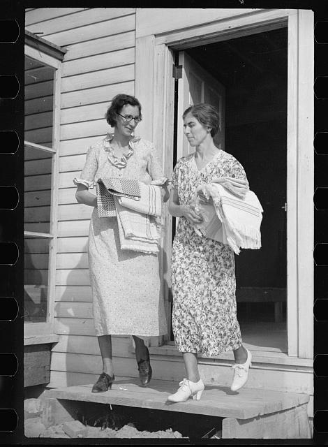 Homesteaders carrying shawls, etc., woven at Tygart Valley Homesteads, West Virginia