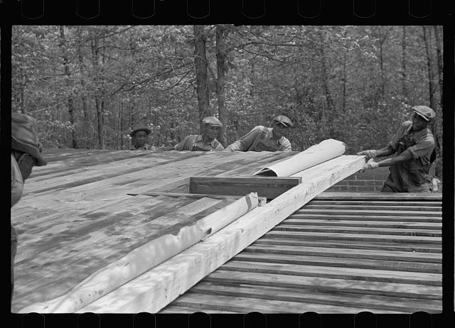 Unloading wall of prefabricated house, Roanoke Farms, North Carolina