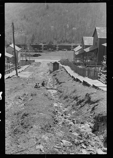 Children playing in street of company town, Kempton, West Virginia. Note open ditches