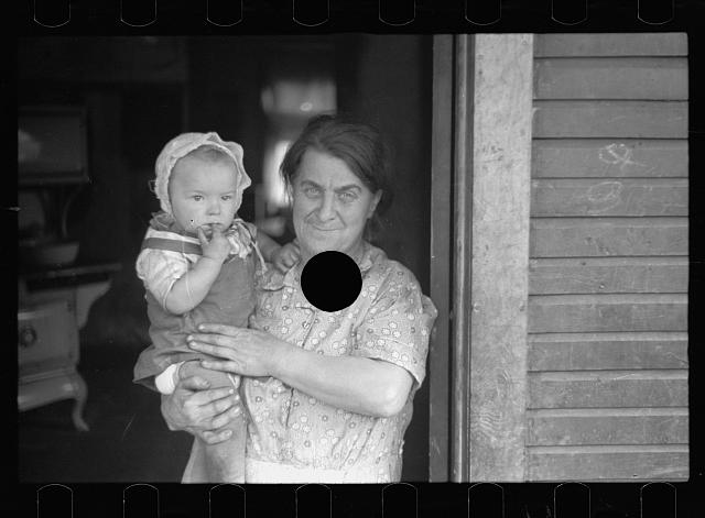 [Untitled photo, possibly related to: Wife of coal miner with grandchild. Kempton, West Virginia]