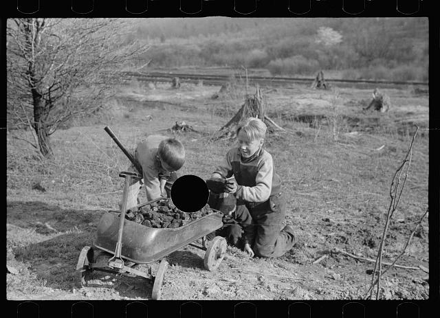 [Untitled photo, possibly related to: Miner's sons bringing home coal which they have salvaged from slag pile.  Kempton, West Virginia]