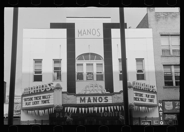 Movie theatre, Elkins, West Virginia. There are two movies in town, both offer games of chance three nights a week to drum up trade on slack nights