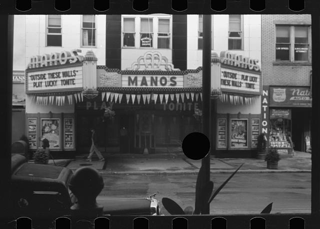 [Untitled photo, possibly related to: Movie theatre, Elkins, West Virginia. There are two movies in town, both offer games of chance three nights a week to drum up trade on slack nights]