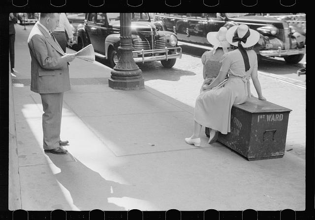 [Untitled photo, possibly related to: Girls waiting for street car, Chicago, Illinois]