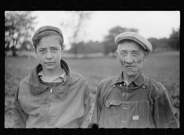Father and son from Chicago picking strawberries in Berrien County, Michigan