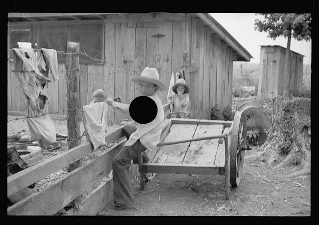[Untitled photo, possibly related to: Sharecropper's child suffering from rickets and malnutrition, Wilson cotton plantation, Mississippi County, Arkansas]
