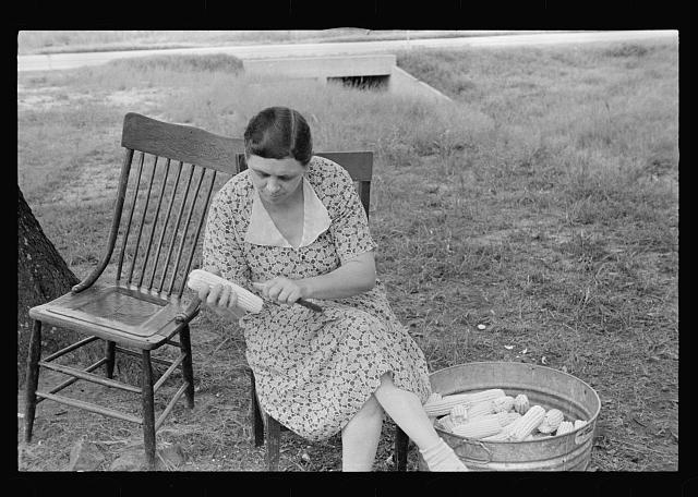 [Untitled photo, possibly related to: Demonstrating process of canning corn at community canning kitchen near Atkins, Arkansas]