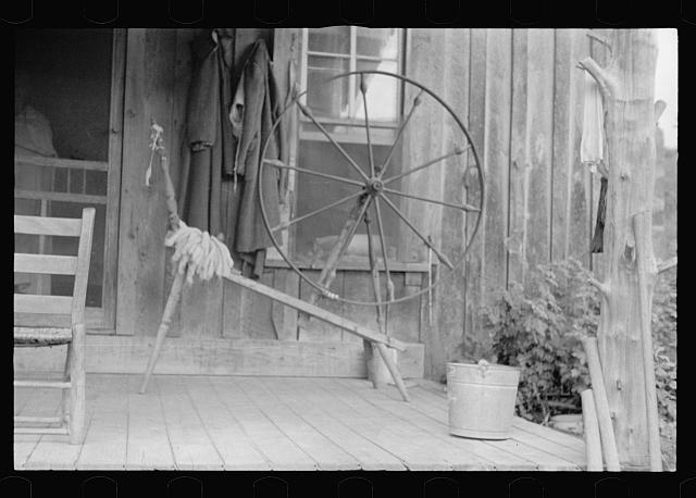 [Untitled photo, possibly related to: Spinning wheel used by a rehabilitation client, Ozark Mountains, Arkansas]
