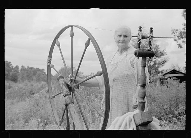 [Untitled photo, possibly related to: Rehabilitation client at spinning wheel, Ozark Mountains, Arkansas]