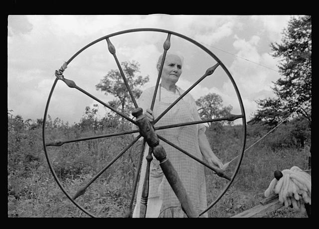 Rehabilitation client at spinning wheel, Ozark Mountains, Arkansas