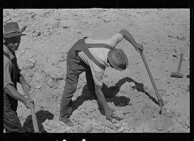 [Untitled photo, possibly related to: Farmers who have been resettled at Skyline Farms, at work in sand pit]