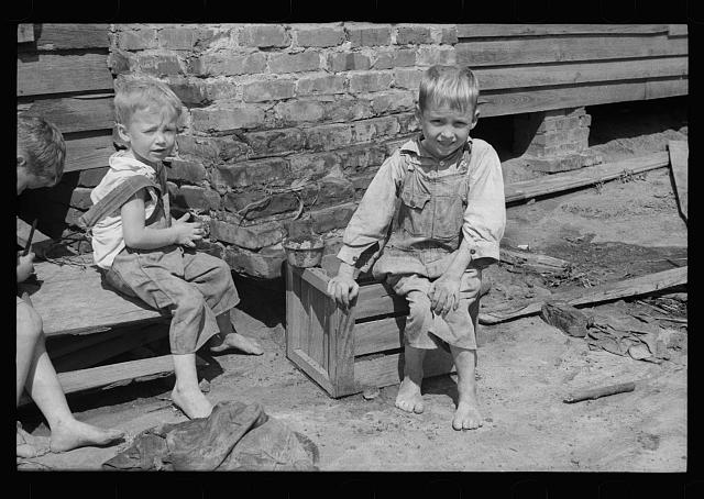 [Untitled photo, possibly related to: Son of a farmer on Wolf Creek Farms project who has not yet been moved to a new house, Wolf Creek Farms, Grady County, Georgia]