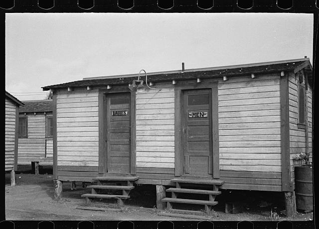 Toilets in the tourist camp for migrant agricultural workers near Belle Glade, Florida