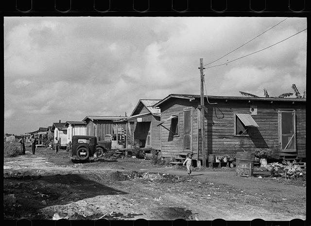 [Untitled photo, possibly related to: A row of houses in the Negro section, Belle Glade, Florida]