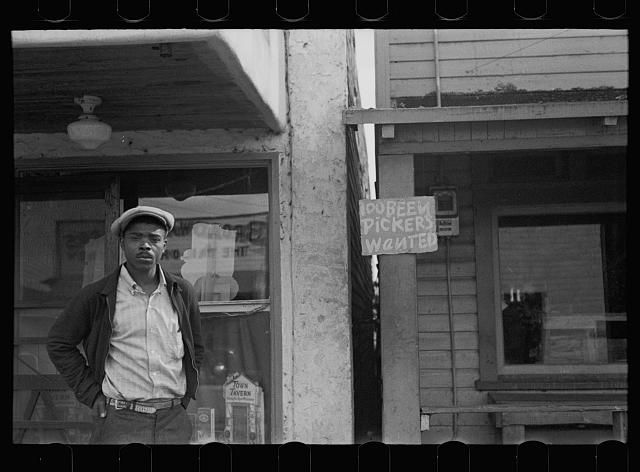 Negro, liquor store and employment notice in the Negro section of Belle Glade, Florida
