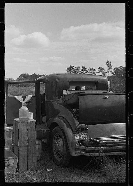 Car used by migratory agricultural workers, the rear of which has been fixed up as a bed, near Winter Haven, Florida