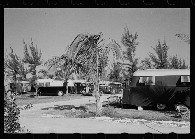 [Untitled photo, possibly related to: Some of the 200 trailers encamped at an auto-trailer camp near Dania, Florida. This is one of the better trailer camps in Florida, the rates being $5.00 weekly including electricity]