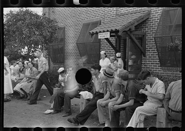 [Untitled photo, possibly related to: Workers in canning plant during change of shift. Many of these are migratory. Polk County, Florida]