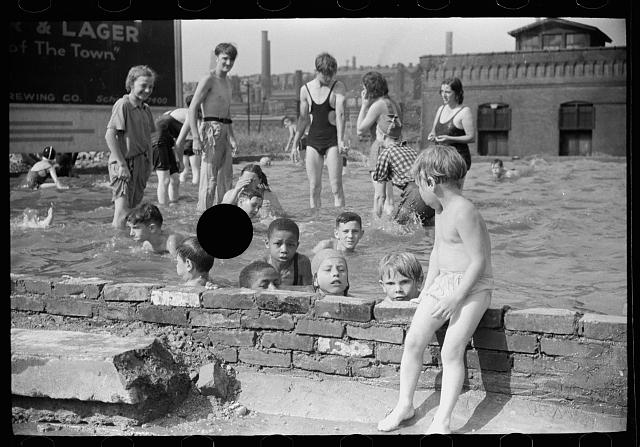 [Untitled photo, possibly related to: Homemade swimming pool for steelworkers' children, Pittsburgh, Pennsylvania]
