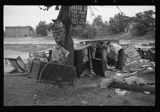 [Untitled photo, possibly related to: Buddy Sheppard and his father, part-time agricultural workers in Bridgetown, New Jersey, raking junk pile for old metal and bottles to sell. During the off-seasons these people must find all manner of strange occupations to round out an inadequate relief diet]