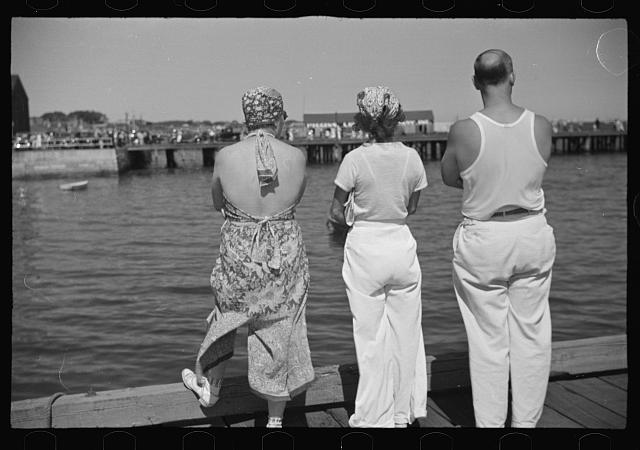 Summer residents watch the tourist boat arrive from Boston, Provincetown, Massachusetts