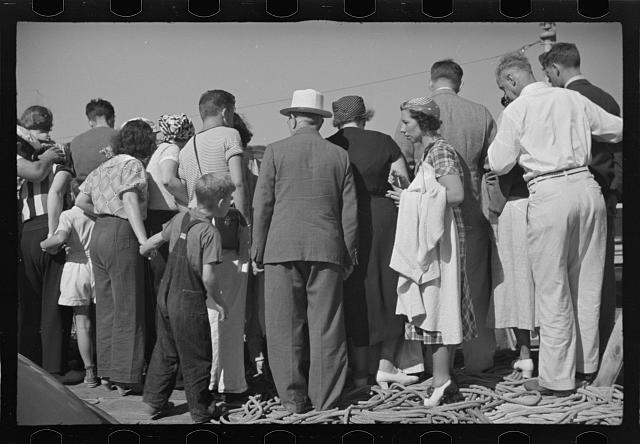 [Untitled photo, possibly related to: Summer residents watch the tourist boat arrive from Boston, Provincetown, Massachusetts]