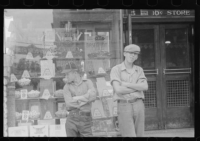 Two boys standing in front of candy store window, street scene, Circleville, Ohio (see general caption)