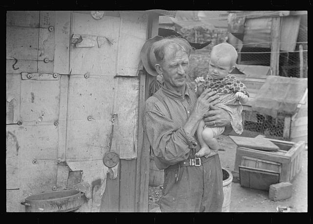Ex-farmer and child, now on W.P.A. (Work Projects Administration), central Ohio