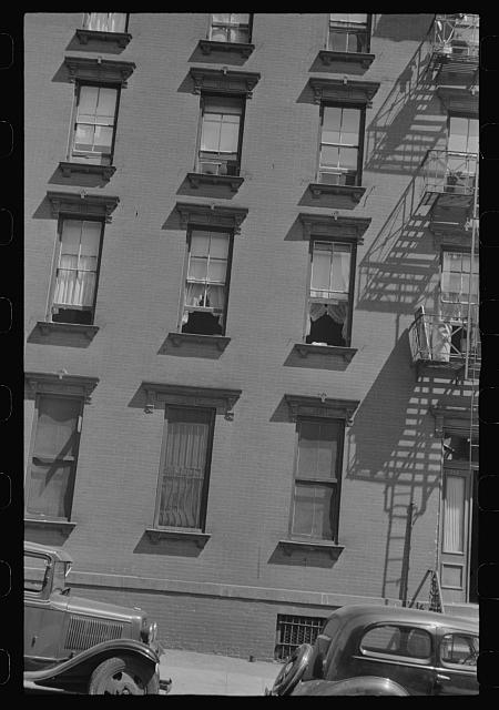 New York, New York. 61st Street between 1st and 3rd Avenues. House fronts