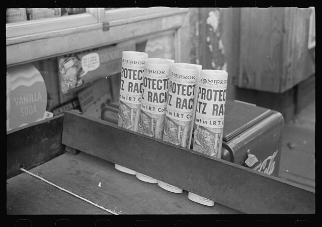 New York, New York. 61st Street between 1st and 3rd Avenues. Newspapers for sale